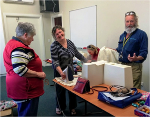 Volunteers making reusable bags stop single use plastic bags in Benalla