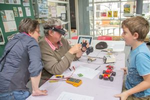 Repairer Phil Shields helps Joanne and Murray fix their remote control car