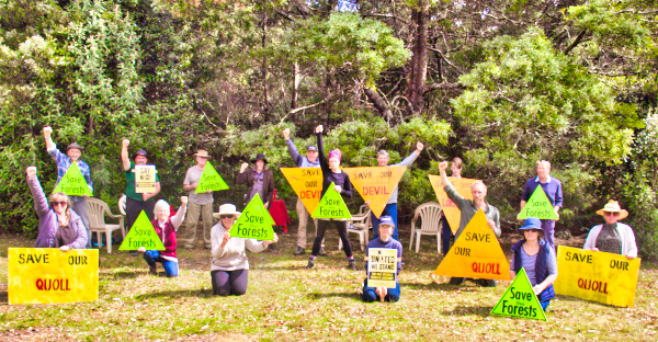People protecting Oldina Forest, holding up signs saying Save Our Quoll, Save our Devil, Save our Forest