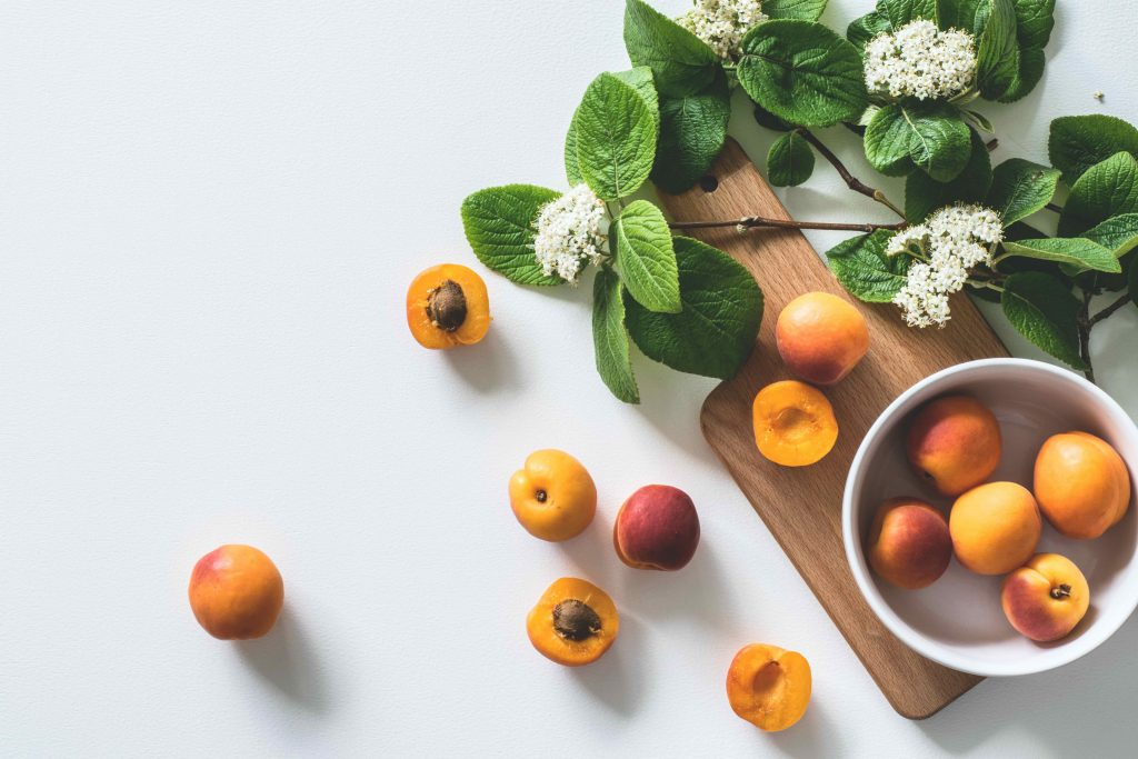 apricots in bowl, some scattered, various ages, changing roles
