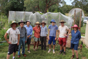 8 people at a garden working bee